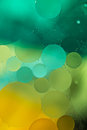 Green, Yellow Gradient Oil drops in the water -abstract background Royalty Free Stock Photo