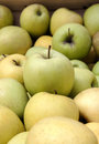 Green and yellow market apples in wood box Stock Images