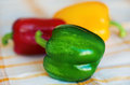 Green, yellow and red bulgarian pepper Stock Photos