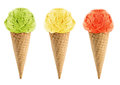 Green yellow and red ice cream in the cone on white background with clipping path Royalty Free Stock Image