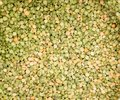Green and yellow split peas Stock Photos
