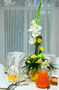 Green, yellow table decor of restaurant event Stock Photos