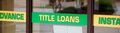 Green and yellow title loan sign an advertisement from fast quick cash car instant cash mart Royalty Free Stock Photography