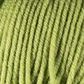 Green yellow wool thread ball macro closeup Royalty Free Stock Photo