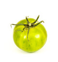 Green zebra tomato one single isolated on a white background Royalty Free Stock Image