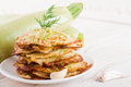 Green zucchini pancakes on a wooden board old Royalty Free Stock Photo