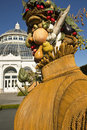 Greenhouse with arcimboldo figure fruit and vegetable sculpture in front of the at new york botanical garden Royalty Free Stock Image