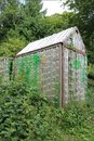 Greenhouse made of old plastic bottles Royalty Free Stock Photo