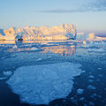 Greenland nature and landscapes of travel on the scientific vessel among ices studying of a phenomenon of global warming ices and Stock Photo