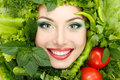 Greens vegetables frame woman beauty face isolated on white background Royalty Free Stock Images