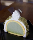 Greentea icecream cake piece of on wood table Stock Image