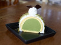 Greentea icecream cake piece of on wood table Royalty Free Stock Image