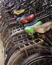 The greern saddle bicycles parked outside an office block in new delhi india Royalty Free Stock Photos