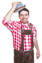 Greeting bavarian man with leather pants and traditional hat Royalty Free Stock Photo