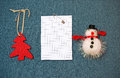 Greeting card and christmas decorations pinned on a blue backgro background Royalty Free Stock Images