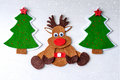 Greeting card handmade christmas rudolph reindeer from felt with christmas tree, red stars Royalty Free Stock Photo