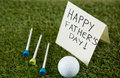 Greeting card with happy fathers day text by golf ball and tees on field Royalty Free Stock Photo