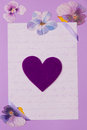 Greeting card in lilac with heart symbol Stock Photo