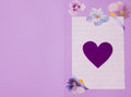 Greeting card in lilac with heart symbol Stock Photography