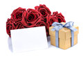 Greeting card with red flowers and gift box a golden silver ribbon bow on a white background Stock Photo