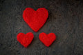 Greeting card for valentine's day handmade one big and two small hearts from felt white and red colour