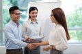 Greeting colleague young vietnamese businessman his female Stock Photos