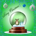 Christmas greeting card with a reindeer in a globe on green background