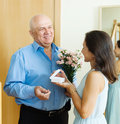 Greeting of loving mature couple with presents at home Stock Photo