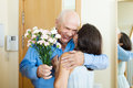 Greeting of mature couple at home Stock Photography