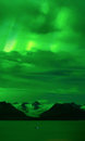 Grewingk Glacier under Green Aurora glow Royalty Free Stock Photo