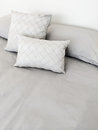 Grey bed linen and pillows with Royalty Free Stock Images