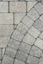 Grey brick paving background pattern and texture a portion of the edge of a circular design with the flooring Stock Image