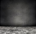 Grey brick wall with tile floor gray tone color modification Royalty Free Stock Photo