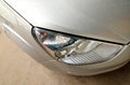 Grey car headlight a closeup details Stock Photography