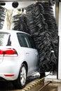 Grey car during washing process Royalty Free Stock Photo