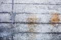 Grey concrete wall with hardened traces of the shuttering moulds Stock Photography