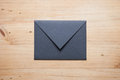 A grey envelope on the wood desk, Royalty Free Stock Photo