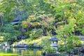 Grey granite lantern in Japanese garden in fall Royalty Free Stock Photo