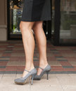 Grey High Heels and Black Skirt Royalty Free Stock Images
