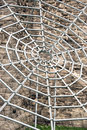 Grey metal spiderweb Royalty Free Stock Photo
