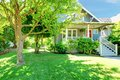 Grey old American house with summer landscape. Royalty Free Stock Photo