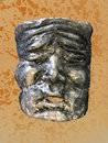 Grey papier mache mask