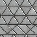 Grey pave slabs in the form of triangles and other geometric shapes seamless tileable texture Royalty Free Stock Photos