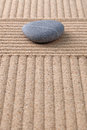 Grey pebble on raked sand vertical Royalty Free Stock Images