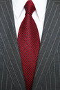 Grey pinstripe suit and red tie Stock Photography