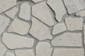 Grey polished stone wall of decorative stones as a fence or for interior design Stock Photos