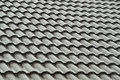 Grey roof tiles in the rain a pattern of on a wet rainy day showing water running down channels Royalty Free Stock Images