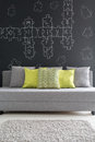 Grey sofa with green cushions Royalty Free Stock Photo