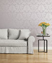 Grey sofa with a purple damask victorian wallpaper Royalty Free Stock Photo