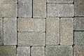 Grey tiles give a harmonic pattern at the ground Royalty Free Stock Photo